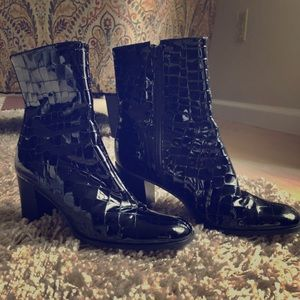Croc style patent leather boots.
